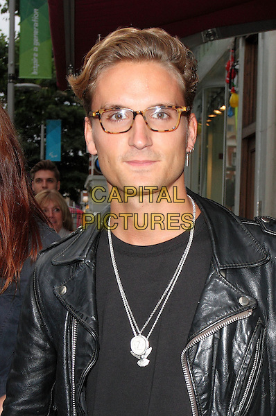 Oliver Proudlock.Launch Party for 'Candy Kittens' pop up shop in the Kings Road, Chelsea, London, England..August 7th 2012.headshot portrait glasses black leather jacket silver necklace .ROS/CAP.©Steve Ross/Capital Pictures