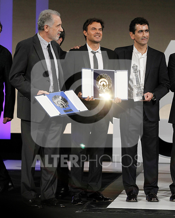 Spanish film director Fernando Trueba with the Silver Shell best director award (l), French film director Francois Ozon with the Golden Shell best film award (c) and the writer Juan Mayorga during the Awards Gala in the 60th San Sebastian Donostia International Film Festival - Zinemaldia.September 29,2012.(ALTERPHOTOS/ALFAQUI/Acero)