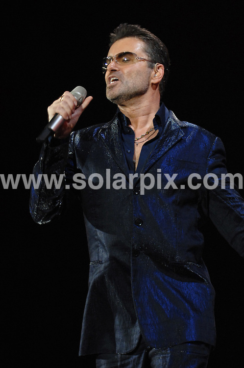 **ALL ROUND PICTURES FROM SOLARPIX.COM**.**WORLDWIDE SYNDICATION RIGHTS EXCLUDING UK & ITALY - NO PUBLICATION IN UK OR ITALY**.George Michael in concert, Milan, Italy. 6 October 2006..This pic: George Michael..JOB REF: 9206 MXN       DATE: 06_10_2006.**MUST CREDIT SOLARPIX.COM OR DOUBLE FEE WILL BE CHARGED**.**ONLINE USAGE FEE GBP 50.00 PER PICTURE - NOTIFICATION OF USAGE TO PHOTO @ SOLARPIX.COM**.**CALL SOLARPIX : +34 952 811 768 or LOW RATE FROM UK 0844 617 7637**