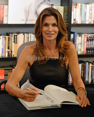 BAL HARBOUR, FL - OCTOBER 06: Cindy Crawford signs copies of her book 'Becoming' at Books and Books on October 6, 2015 in Bal Harbour, Florida. Credit: mpi04/MediaPunch