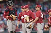 Alabama Crimson Tide on the mound with Alabama Crimson Tide pitcher Spencer Turnbull (32) at Baum Stadium during the NCAA baseball game against the Arkansas Razorbacks on March 21, 2014 in Fayetteville, Arkansas.  The Alabama Crimson Tide defeated the Arkansas Razorbacks 17-9.  (William Purnell/Four Seam Images)