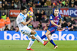 Jordi Alba of FC Barcelona (R) attempts a kick while being defended by Juan Francisco Moreno Fuertes of Deportivo La Coruna (L) during the La Liga 2017-18 match between FC Barcelona and Deportivo La Coruna at Camp Nou Stadium on 17 December 2017 in Barcelona, Spain. Photo by Vicens Gimenez / Power Sport Images