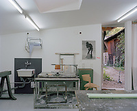 One end of the artist's studio is equipped with a potters wheel and sink