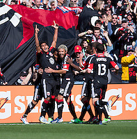 Rafael Teixeira (9) of D.C. United celebrates with teammates after scoring during the game at RFK Stadium in Washington, DC.  Columbus Crew defeated D.C. United, 2-1.