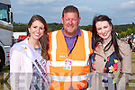 Tom Leslie has a Rose in each hand Kerry Rose Mary Hickey and 2013 Kerry Rose Gemma Kavanagh at the South Kerry Ploughing Championships in Fossa on Sunday