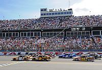 Apr 26, 2009; Talladega, AL, USA; NASCAR Sprint Cup Series driver Kyle Busch (18) leads David Ragan (6) during the Aarons 499 at Talladega Superspeedway. Mandatory Credit: Mark J. Rebilas-