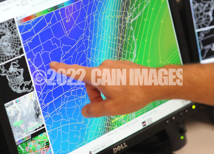 Joseph Miketta, of the National Weather Service Mount Holly Station points to a ma that shows the amount of precipitation  Tuesday August 23, 2016 in Mt. Holly, New Jersey. (Photo by William Thomas Cain)