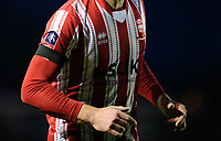 A close up of an Emirates FA Cup badge on a Lincoln City shirt, worn by Harry Toffolo<br /> <br /> Photographer Chris Vaughan/CameraSport<br /> <br /> The Emirates FA Cup Second Round - Lincoln City v Carlisle United - Saturday 1st December 2018 - Sincil Bank - Lincoln<br />  <br /> World Copyright © 2018 CameraSport. All rights reserved. 43 Linden Ave. Countesthorpe. Leicester. England. LE8 5PG - Tel: +44 (0) 116 277 4147 - admin@camerasport.com - www.camerasport.com