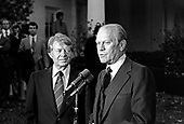 "United States President Gerald R. Ford, right, and US President-elect Jimmy Carter, left, meet reporters outside the Oval Office of the White House in Washington, D.C. following their discussions on the transition on November 22, 1976.  This is the first meeting between the two men since the Presidential debates during the campaign.<br /> Credit: Benjamin E. ""Gene"" Forte / CNP"