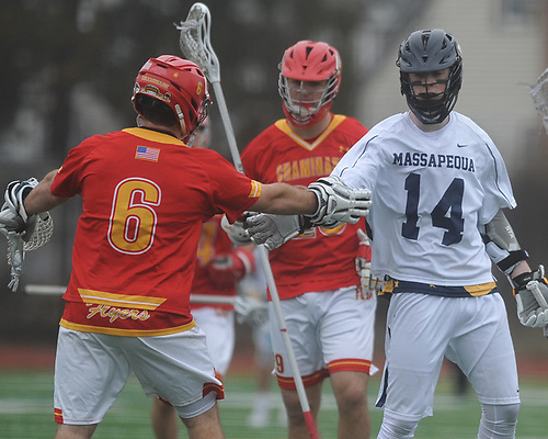 Colin Gleason #14 of Massapequa, right, shakes hands with Chaminade goalie #6 Andrew Bonafede after a non-league varsity boys lacrosse game between their respective teams at Massapequa High School on Wednesday, April 4, 2018. Chaminade won by a score of 8-5.