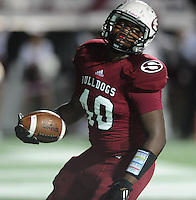 NWA Democrat-Gazette/ANDY SHUPE<br /> Kamryn Dickerson of Springdale scores a touchdown Friday, Oct. 9, 2015, against Fayetteville during the first half of play at Jarrell Williams Bulldog Stadium in Springdale. Visit nwadg.com/photos to see more photographs from the game.