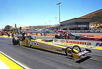 Jul. 28, 2013; Sonoma, CA, USA: NHRA top fuel dragster driver Morgan Lucas (near) races alongside David Grubnic during the Sonoma Nationals at Sonoma Raceway. Mandatory Credit: Mark J. Rebilas-