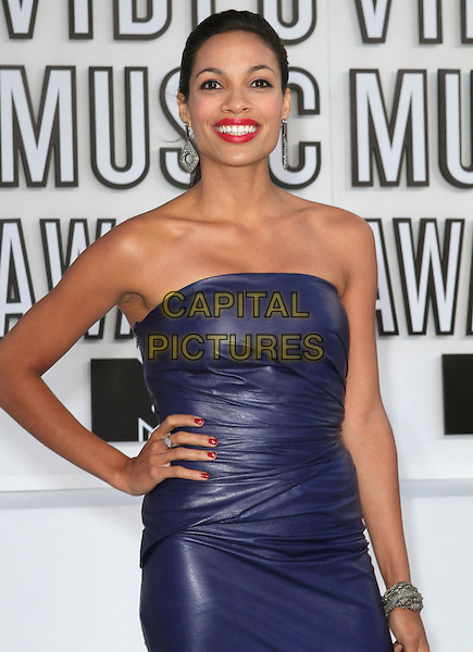 ROSARIO DAWSON .2010 MTV Video Music Awards held at the Nokia Theatre L.A. LIVE, Los Angeles, California, USA, .12th September 2010..VMAS arrivals half  length leather blue dress ruched hand on hip patent purple smiling hair up red lipstick make-up ponytail .CAP/ADM/KB.©Kevan Brooks/AdMedia/Capital Pictures.