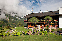 The garden around this traditional chalet enjoys some stunning views of the surrounding mountains