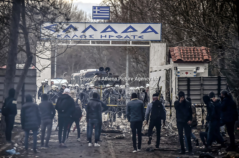 Pictured: Migrants by the Turkish side of the border face Greek riot police in Andrianoupolis. Sunday 01 March 2020<br /> Re: Clashes between migrants and riot police at the Greek-Turkish border of Kastanies near Evros, Greece