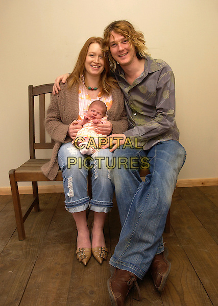 ADAM & TERRI WAKEMAN.At their home with their 3 week old daughter.March 13th, 2005.son of Rick Wakeman family father mother infant baby full length.www.capitalpictures.com.sales@capitalpictures.com.© Capital Pictures.