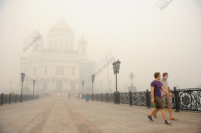 In central Moscow by the cathedral of Christ the Saviour a thick stinging smog enveloped the city and many donned masks to escape its effects as the hot weather and the forest and turf fires outside the capital showed little sign of abating. 06 August 2010