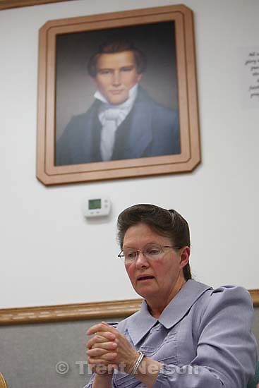 Eldorado - Marianne, an FLDS woman on the YFZ Ranch Wednesday, April 16, 2008, tells the story of being taken with her four daughters in the raid. Above her is a portrait of Joseph Smith, which both the polygamous FLDS and mainstream LDS church revere as a founding prophet..  Wednesday April 16, 2008.