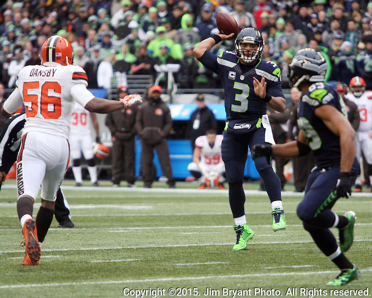 Seattle Seahawks quarterback Russell Wilson looks to pass to wide receiver Doug Baldwin against the Cleveland Browns at CenturyLink Field in Seattle, Washington on December 20, 2015. The Seahawks clinched their fourth straight playoff berth in four seasons by beating the Browns 30-13.  ©2015. Jim Bryant Photo. All Rights Reserved.
