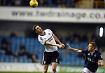 Chris Basham of Sheffield United is challenged by Shane Ferguson of Millwall during the championship match at The Den Stadium, Millwall. Picture date 2nd December 2017. Picture credit should read: Robin Parker/Sportimage