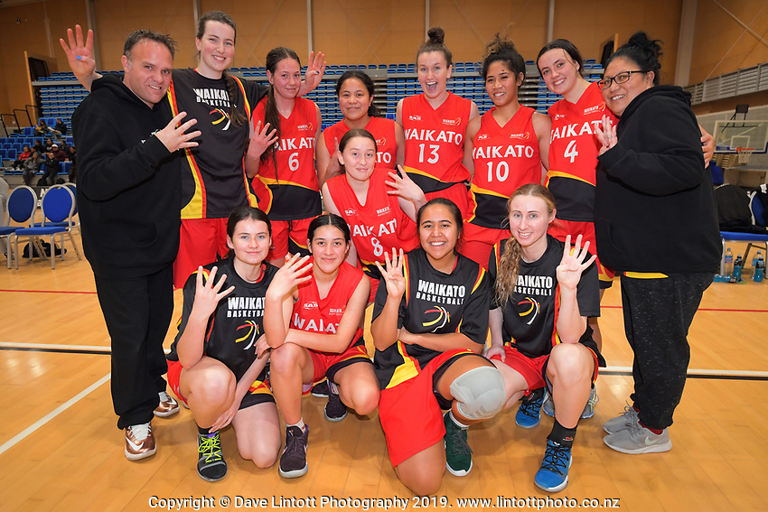 Waikato celebrate their fourth national title in a row after the National Under-23 Basketball Championship women's final between Waikato and Otago at Te Rauparaha Arena in Porirua, New Zealand on Saturday, 10 August 2019. Photo: Dave Lintott / lintottphoto.co.nz