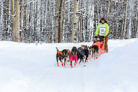 Kathernine Winrich on the trail passes Knik Hall after leaving the start at Knik Lakeat Knik during the start of the Junior Iditarod on Saturday February 25, 2017. <br /> <br /> <br /> Photo by Jeff Schultz/SchultzPhoto.com  (C) 2017  ALL RIGHTS RESVERVED