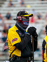 Jul 19, 2020; Clermont, Indiana, USA; An NHRA official wears a face covering mask during the Summernationals at Lucas Oil Raceway. Mandatory Credit: Mark J. Rebilas-USA TODAY Sports