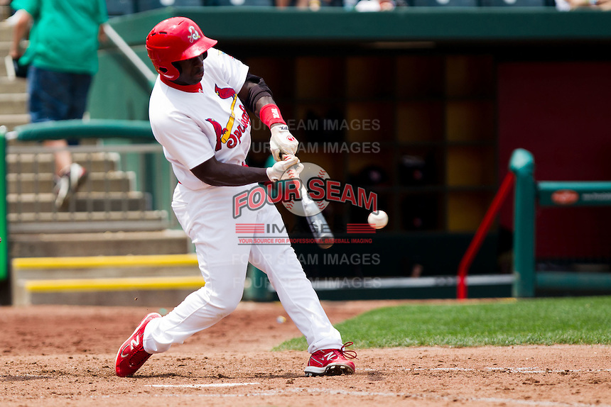 Jermaine Curtis (5) of the Springfield Cardinals makes contact on a pitch during a game against the Arkansas Travelers on May 10, 2011 at Hammons Field in Springfield, Missouri.  Photo By David Welker/Four Seam Images.