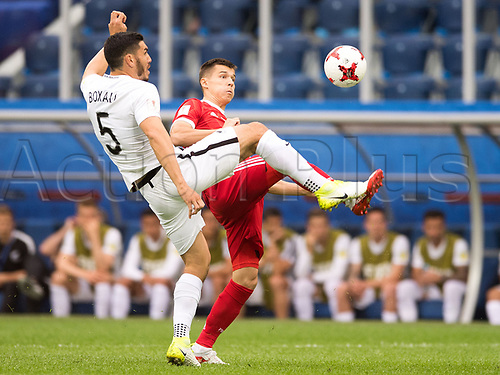 17th June 2017, St Petersburg, Russia; FIFA 2017 Confederations Cup football, Russia versus New Zealand; Group A - Saint Petersburg Stadium,  Russia's Dmitry Poloz (r) and New Zealand's  Michael Boxall vie for the ball during the Confederations Cup Group A soccer match between Russia and New Zealand at the stadium in Saint Petersburg, Russia