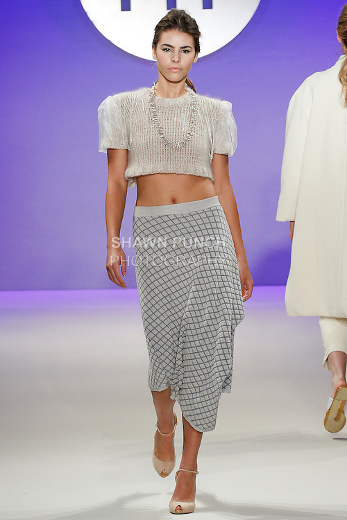 Model walks runway in an outfit by Ji Yeon Lee, during the FIT Future of Fashion 2014 Graduates' Collection fashion show, at the Fashion Institute of Technology on May 1, 2014.