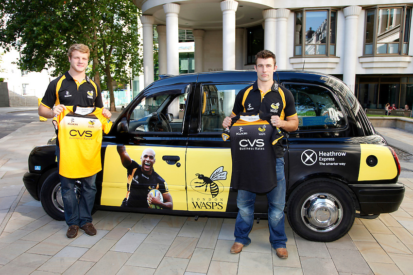 Photo: Richard Lane/Richard Lane Photography. London Wasps reception at the Central London offices of the Club's Official Main Sponsor, CVS, the business rates specialist. 02/09/2013. Wasps players, Joe Launchbury and Chris Bell.