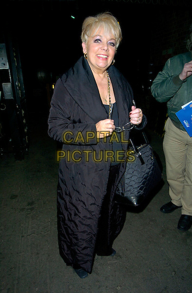 "MEG JOHNSON.Attends ""Follies"" Gala Concert at the London Palladium,.London, England, February 4th 2007..full length black coat bag.CAP/CAN.©Can Nguyen/Capital Pictures"