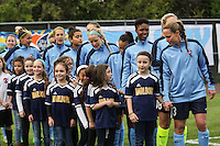 Piscataway, NJ, May 7, 2016. The starting eleven for Sky Blue FC and their player escorts enter the field. The Western New York Flash defeated Sky Blue FC 2-1 in a National Women's Soccer League (NWSL) match at Yurcak Field.