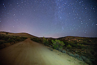 Aug. 22, 2014; BLACK CANYON CITY, AZ, USA; The Milky Way Galaxy and other stars are visible over a dirt road in the Arizona sky as viewed from the desert near Black Canyon City, AZ. Mandatory Credit: Mark J. Rebilas