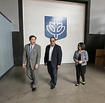 Alex Pissios, center, president of Cinespace Chicago, leads A. Gabriel Esteban, Ph.D., president of DePaul, and his wife Josephine, on a tour of the school's studios and classroom facilities Tuesday, Aug. 1, 2017, at the Cinespace Chicago Film Studios. (DePaul University/Jamie Moncrief)