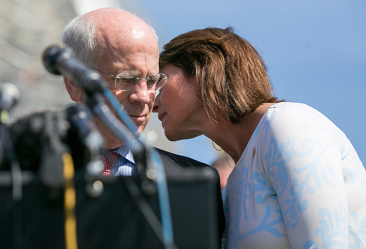 UNITED STATES - JUNE 10 - Rep. Cheri Bustos, D-Ill., whispers to Peter Welch, D-Vt., during a news conference to discuss efforts to break the current impasse over long-term funding for the federal highway program on Capitol Hill in Washington, Friday, July 10, 2015.(Photo By Al Drago/CQ Roll Call)