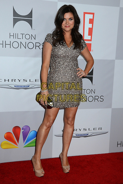 Tiffani Thiessen.NBC Universal Golden Globes After Party held at the Beverly Hilton Hotel, Hollywood, California, USA..January 15th, 2012.full length silver beads beaded dress hand on hip beige peep toe shoes clutch bag.CAP/ADM/BT.©Birdie Thompson/AdMedia/Capital Pictures.