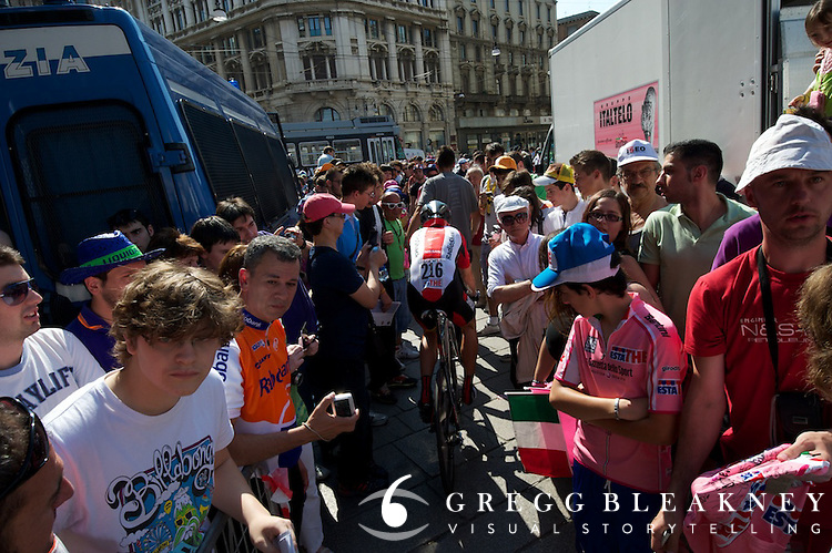 The gauntlet--a narrow gap of enthusiastic fans that awaited every rider when leaving the secured podium area en route to team buses.