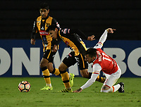 BOGOTA - COLOMBIA - 23 - 05 - 2017: Jonathan Gomez (Der.) jugador de Independiente Santa Fe, disputa el balón con Diego Wayar (Izq.) jugador de The Strongest, durante partido entre Independiente Santa Fe de Colombia y The Strongest de Bolivia, de la fase de grupos, grupo 2, fecha 6 por la Copa Conmebol Libertadores Bridgestone 2017, en el estadio Nemesio Camacho El Campin, de la ciudad de Bogota. / Jonathan Gomez (R) player of Independiente Santa Fe, fights for the ball with Diego Wayar (L) player of The Strongest during a match between Independiente Santa Fe of Colombia and The Strongest of Bolivia, of the group stage, group 2 of the date 6th, for the Conmebol Copa Libertadores Bridgestone 2017 at the Nemesio Camacho El Campin in Bogota city. VizzorImage / Luis Ramirez / Staff.