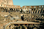 Rome, Italy - April 2, 2006 -- The Colosseum was commissioned by the Roman Emperor Vespasian in AD 72 and was completed in AD 80.  It is considered as Rome's greatest amphitheatre. Deadly gladiatorial combats and wild animal fights were staged there by emperors and wealthy citizens.  It had a capacity of 55,000 people.  Rome, Italy - April 2, 2006 -- The Colosseum was commissioned by the Roman Emperor Vespasian in AD 72 and was completed in AD 80.  It is considered as Rome's greatest amphitheatre. Deadly gladiatorial combats and wild animal fights were staged there by emperors and wealthy citizens.  It had a capacity of 55,000 people.  The platform at bottom center was built recently for events such as rock concerts.  It is built where the original arena floor existed.  The ruins underneath were where the wild animals and gladiators were kept before their combat in the arena..Credit: Ron Sachs / CNP