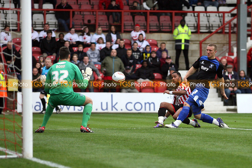 Shaleum Logan of Brentford scores the third goal -  Brentford vs Bury - at the Griffin Park Stadium - 07/04/12 - MANDATORY CREDIT: Dave Simpson/TGSPHOTO - Self billing applies where appropriate - 0845 094 6026 - contact@tgsphoto.co.uk - NO UNPAID USE.