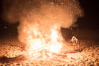 Party around a fire on Paradise Beach (Sar Sar Aw Beach) at night, Dawei Peninsula, Myanmar (Burma)