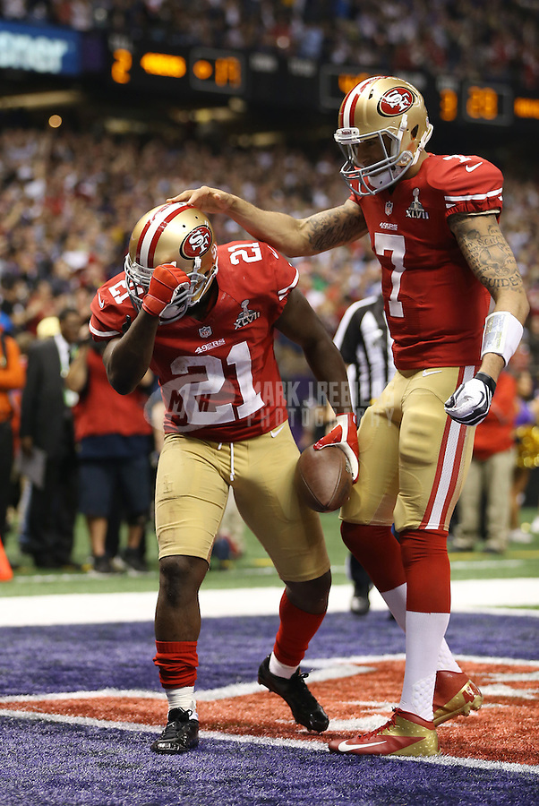 Feb 3, 2013; New Orleans, LA, USA; San Francisco 49ers running back Frank Gore (21) celebrates with quarterback Colin Kaepernick (7) after scoring a touchdown against the Baltimore Ravens in the third quarter during Super Bowl XLVII at the Mercedes-Benz Superdome.  Mandatory Credit: Mark J. Rebilas-
