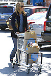3-24-09 Exclusive.Kim Raver Shopping at Whole Foods in Santa Monica California with an US weekly Magazine in her bag...AbilityFilms@yahoo.com.805-427-3519.www.AbilityFilms.com