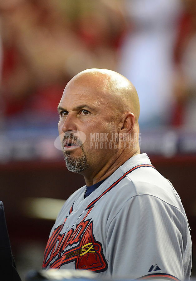 Apr. 22, 2012; Phoenix, AZ, USA; Atlanta Braves manager Fredi Gonzalez in the seventh inning against the Arizona Diamondbacks at Chase Field.  Mandatory Credit: Mark J. Rebilas-