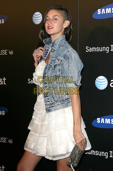 CAROLINE D'AMORE .The Samsung Infuse 4G Launch Event  held at Milk Studios in Hollywood, California, USA..May 12th, 2011.half length white blue jean denim jacket shaved head hair dress blue side gold clutch bag.CAP/RKE/DVS.©DVS/RockinExposures/Capital Pictures.