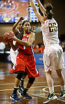 SIOUX FALLS MARCH 22:  Victoria Dye #1 of Francis Marion looks past Alaska Anchorage defender Jessica Madison #25 during their quarterfinal game at the NCAA Women's Division II Elite 8 Tournament at the Sanford Pentagon in Sioux Falls, S.D.  (Photo by Dick Carlson/Inertia)