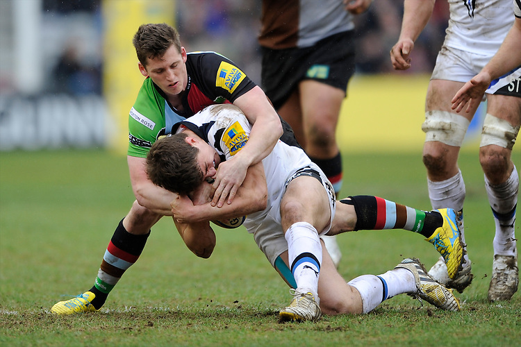 Tom Williams of Harlequins tackled Ollie Devoto of Bath Rugby during the Aviva Premiership match between Harlequins and Bath Rugby at the Twickenham Stoop on Saturday 13th April 2013 (Photo by Rob Munro)