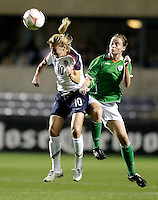 US midfielder Aly Wagner (10) heads the ball in front of Irish midfielder Mary McDonnell (17).  The US Women's National Team defeated Ireland 2-0 at Toyota Park in Bridgeview, IL on September 20, 2008.  Photo by Tracy Allen/isiphotos.com