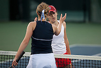 STANFORD, CA - January 26, 2011: Nicole Gibbs of Stanford women's tennis shakes hands after her match against UC Davis' Megan Heneghan. Gibbs won 6-0, 6-2.